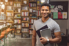 African man standing in campus library Stock Photography