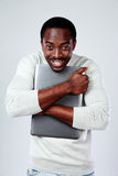 African man standing with laptop Royalty Free Stock Photo