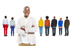 African Man Standing Out From the Crowd Stock Image