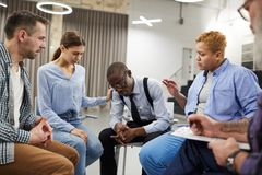 African Man in Support Group. Portrait of young African-American men sharing troubles with support group in therapy session, copy space royalty free stock photo