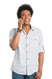 African Man Talking On Cellphone. Young Smiling African Man Talking On Cellphone Isolated on White Background royalty free stock photo