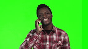 African man talking on smartphone. On green screen stock video