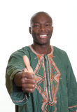 African man with traditional clothes showing thumb up. Handsome african man with traditional clothes showing thumb up on an isolated white background Stock Photo