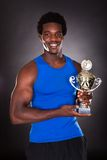 African Man With Trophy Royalty Free Stock Images