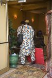 African man turning his back in retail store in Corsica, France, Europe Royalty Free Stock Photography