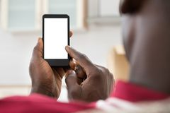 African Man Using Cellphone. Close-up Photo Of African Man Holding Cellphone stock images