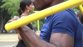 African Man Using Exercise Machine stock video