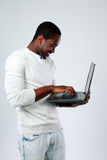 African man using laptop while standing up Royalty Free Stock Images