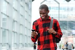 African man using mobile phone at train station Royalty Free Stock Image