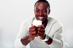 African man using smartphone Stock Photography