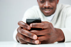 African man using smartphone Stock Image