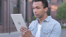 African man using tablet outdoor stock video