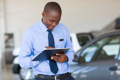 African man vehicle showroom Royalty Free Stock Photography