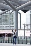 African man walking alone at airport Royalty Free Stock Photos