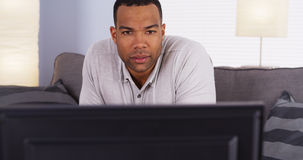 African man watching the game on TV Stock Images