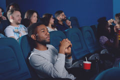 African man watching movie in 3d glasses. Side view of young african men watching movie in 3d glasses and looking at projector against. Man spending free time Royalty Free Stock Photos