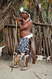 African man wearing traditional costume at Lesedi Cultural Villa Stock Images