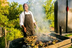 Free African Man Working A BBQ Grill In Urban Soweto Royalty Free Stock Photo - 183401925