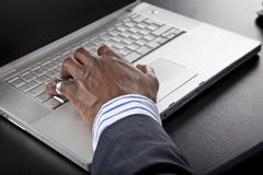 African man working on a computer Royalty Free Stock Photos