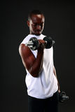 African man working out with dumbbells. Portrait of african man working out with dumbbells Stock Photo