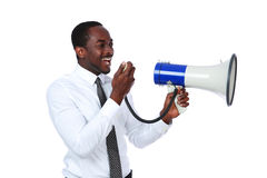 African man yelling through a megaphone. Isolated on a white background Royalty Free Stock Images