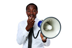 African man yelling through a megaphone. Isolated on a white background Royalty Free Stock Photos