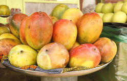 African Mangoes. Plate of Mangoes photographed at a produce stand in Accra Ghana Royalty Free Stock Photography