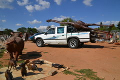 African Market. Transporting a huge steel giraffe on the back of a pickup, South Africa Stock Images