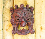 African mask. On wooden wall royalty free stock photography