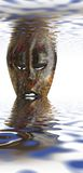African mask. Photo of African mask in setting Royalty Free Stock Photos