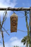 African mask. Example of african tribal art, entance to tourist village,Tenerife stock images