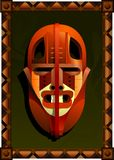 African mask. The African fighting mask. Stylized design Stock Images