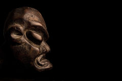African mask over black background stock image