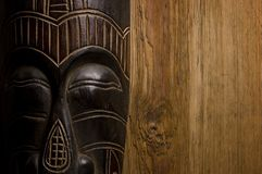 African mask over wooden background. With copy space Royalty Free Stock Images