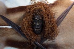 African mask. An African mask with a spear on an antelope coat Royalty Free Stock Photos