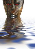 African mask in water. Photo of an African mask - with water reflections added Stock Image