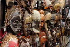 African Masks. Many traditional wooden African Masks Stock Photo