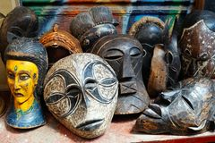 African Masks at Athens Flea Market. A collection of traditional wooden African masks for sale at an Athens Flea Market stall, Greece Royalty Free Stock Photos