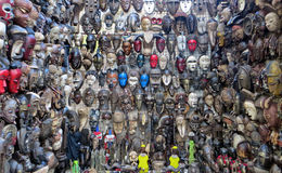 African Masks. Closeup of a colourful outside market stand of various masks in Green Market, Cape Town, South Africa Royalty Free Stock Image
