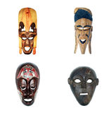 African masks (collection). Handmade antique african masks, isolated Royalty Free Stock Image