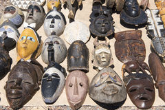 Handmade wooden african masks made from native inhabitants with symbols and expressions Stock Image