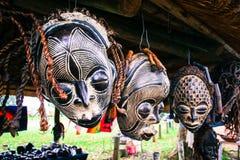 African Masks. Hanging on display royalty free stock image
