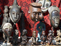 African masks and statues at a flea market Stock Images
