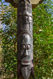 African masks wooden totem sculptures Stock Photos