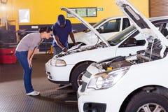 African mechanic customer Stock Photography