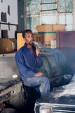 African mechanic smoking Stock Photo