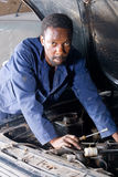 African mechanic at work Stock Images