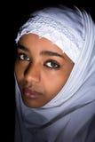 African melancholy. Melancholic Ethiopian girl wearing an islamic white veil Stock Photos