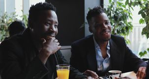 African friends argue in a cafe