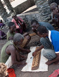 African men playing  traditional game. Royalty Free Stock Photos